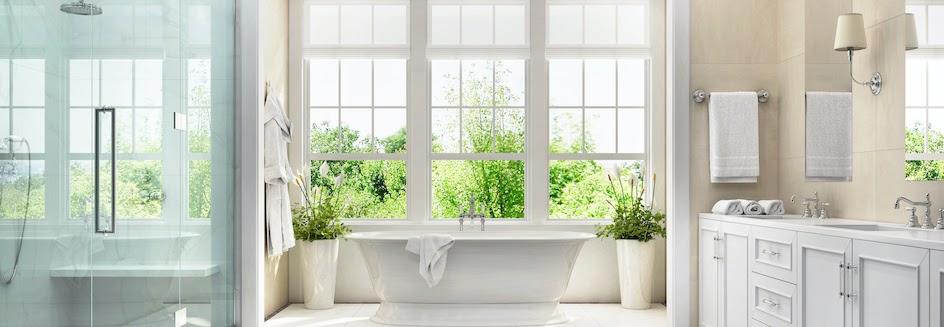Bathroom window ideas: Bright and cheery bathroom with tub at centre