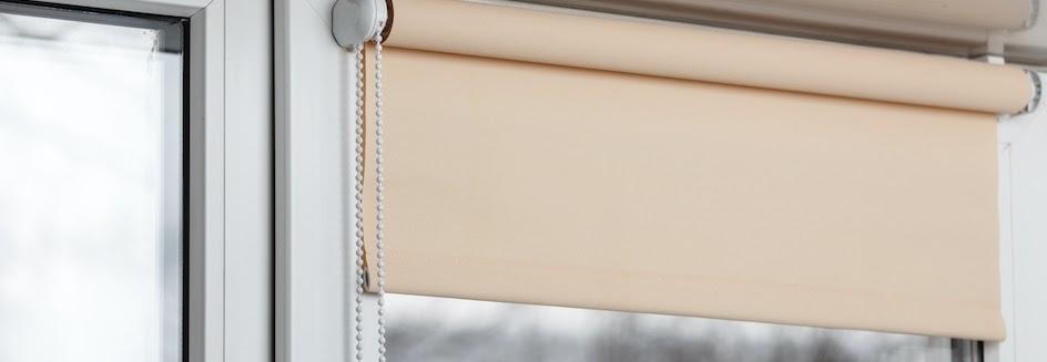 Closeup of tan blackout blinds