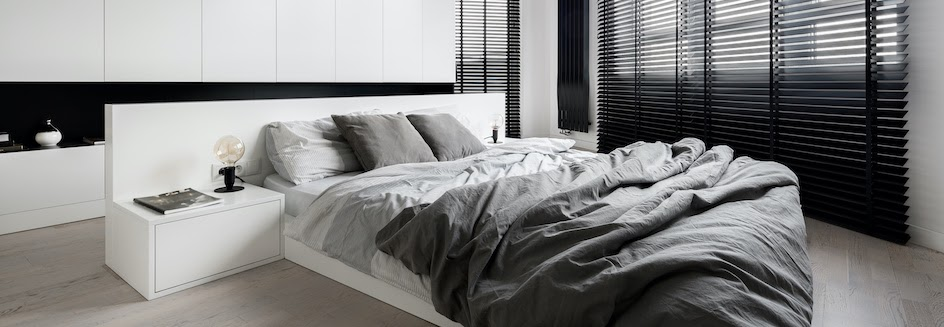 Black and white bedroom with blackout venetian blinds
