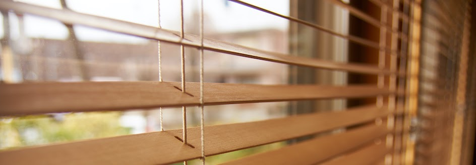 Closeup of faux wood blinds