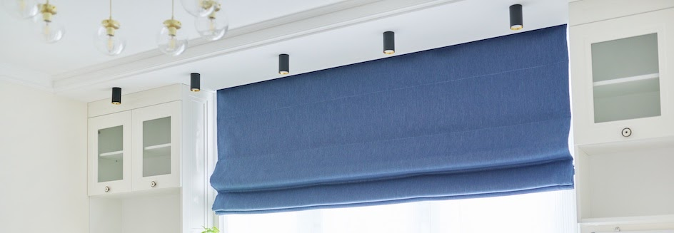 Navy roman blinds rolled up