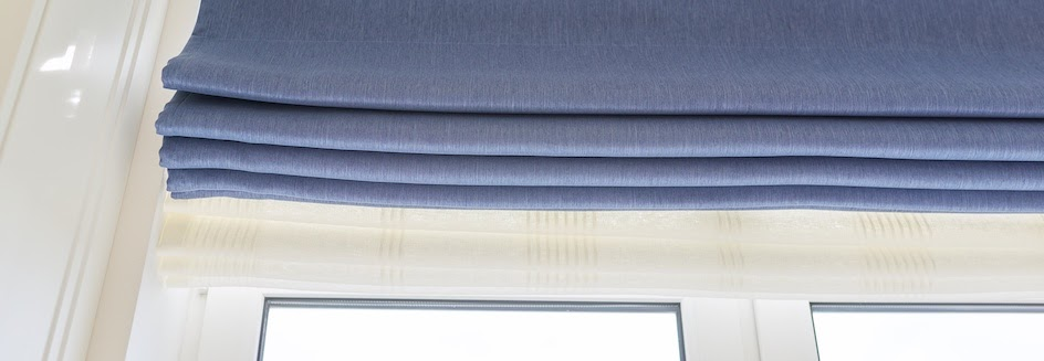 Closeup of blue wide roman blinds
