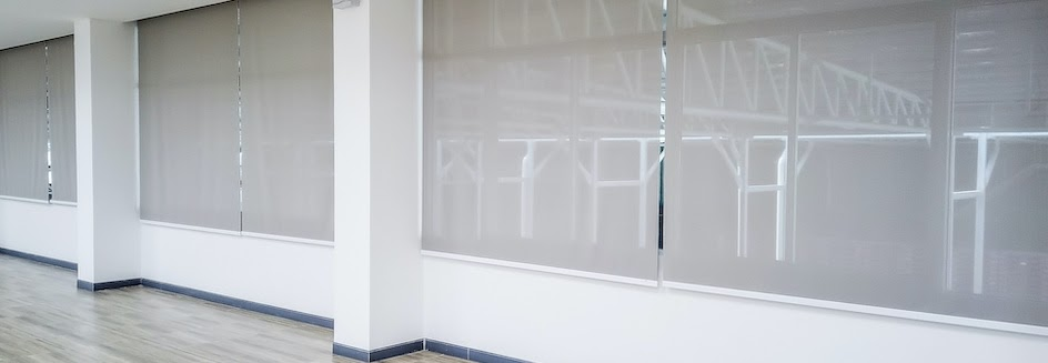 Tension fit roller blinds in office