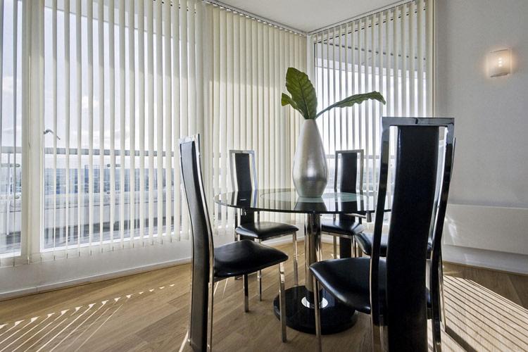 Vertical blinds in white across a patio door