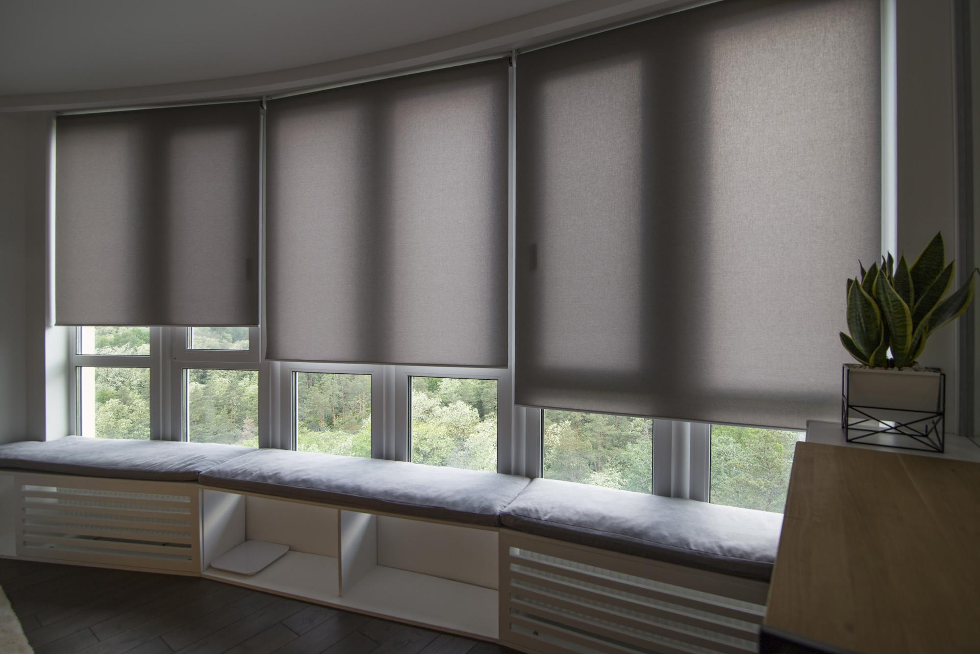 Three windows with sheer roller blinds