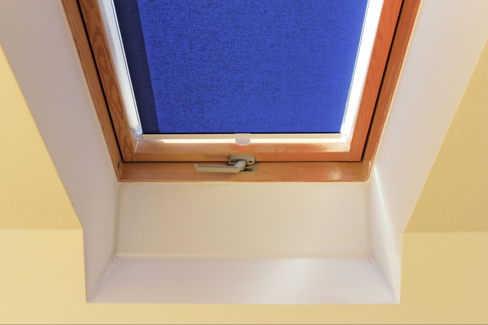 fitting Velux skylight blinds