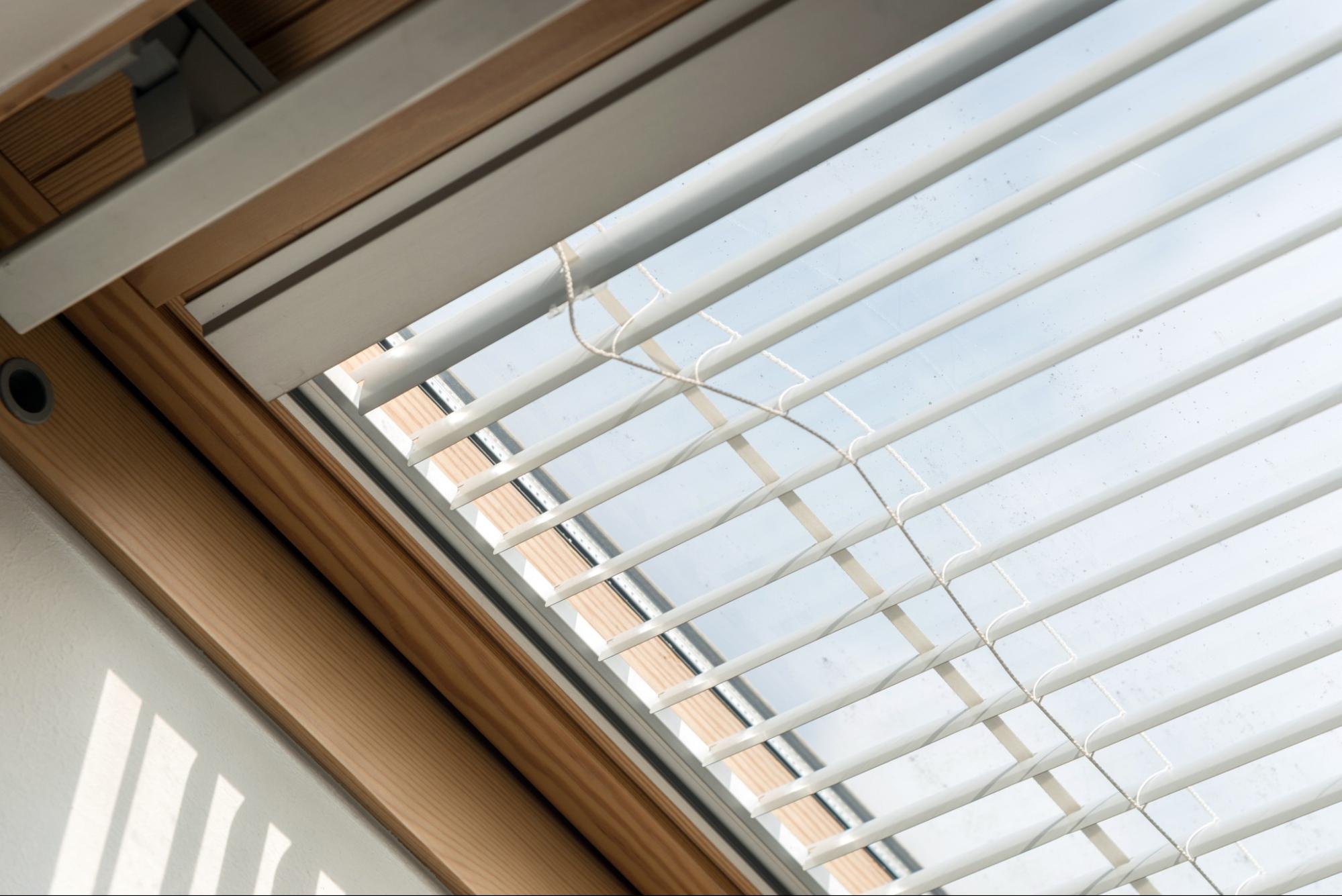 fitting Velux skylight window blinds