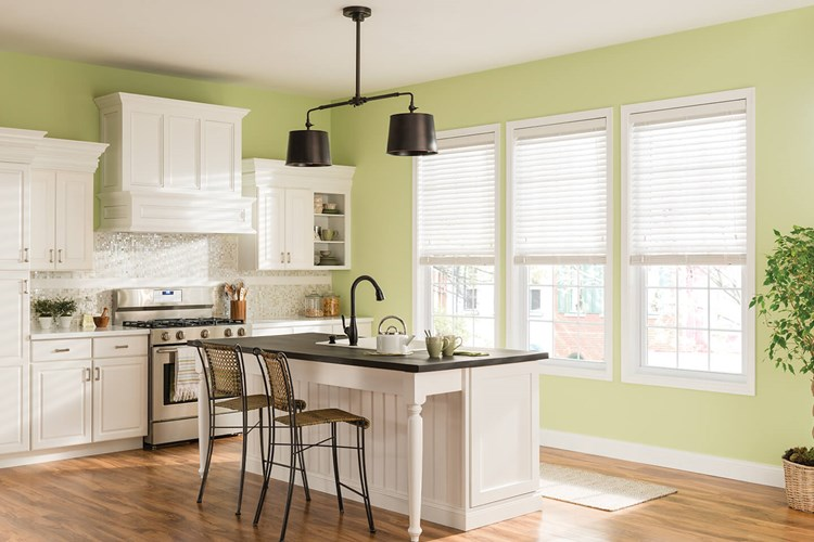 kitchen with white wooden venetian blinds in window