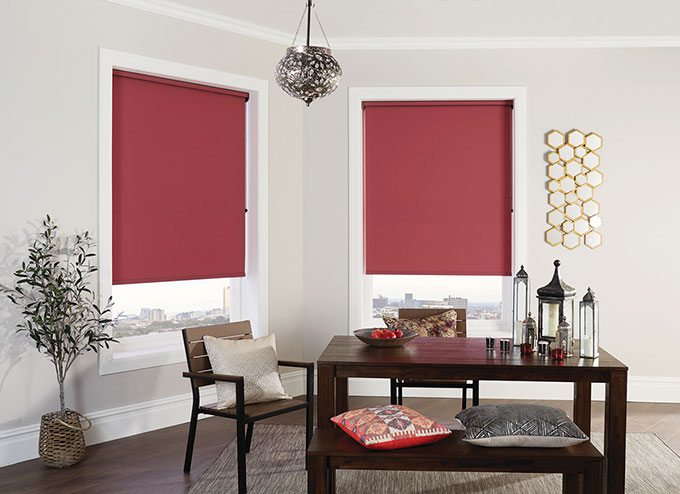 red roller blinds in a living room