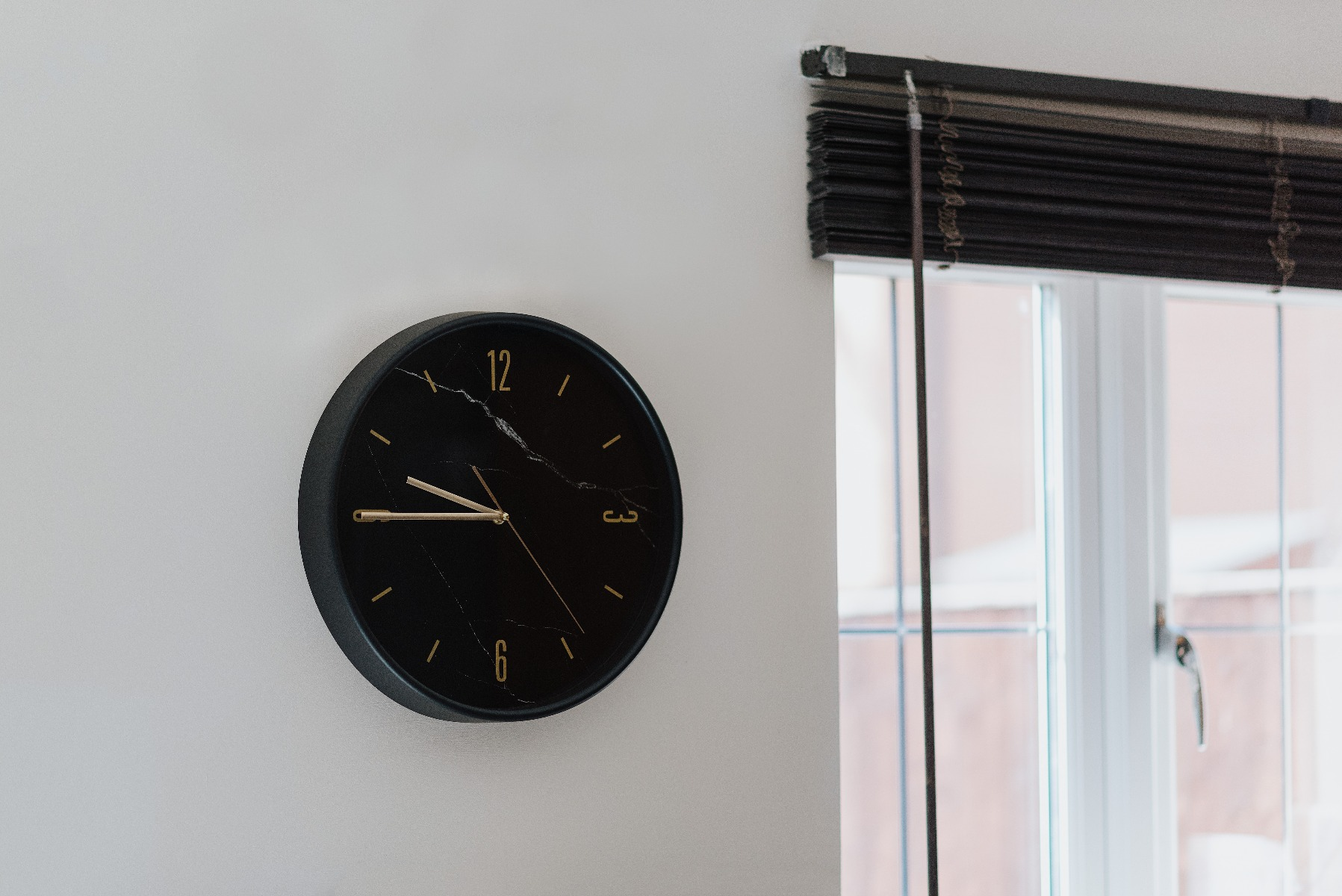 tape on black wooden blind which is raised