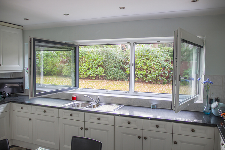 tilit and turn windows above the kitchen sink