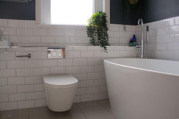 white tiled bathroom with open window