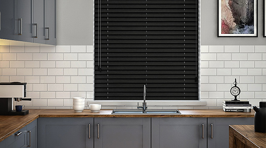 A black wooden blind in a kitchen window